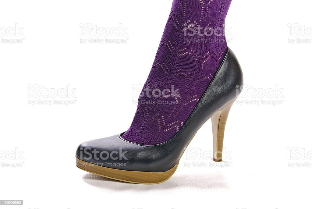 female leg in pantyhose and shoes on high heels royalty-free stock photo