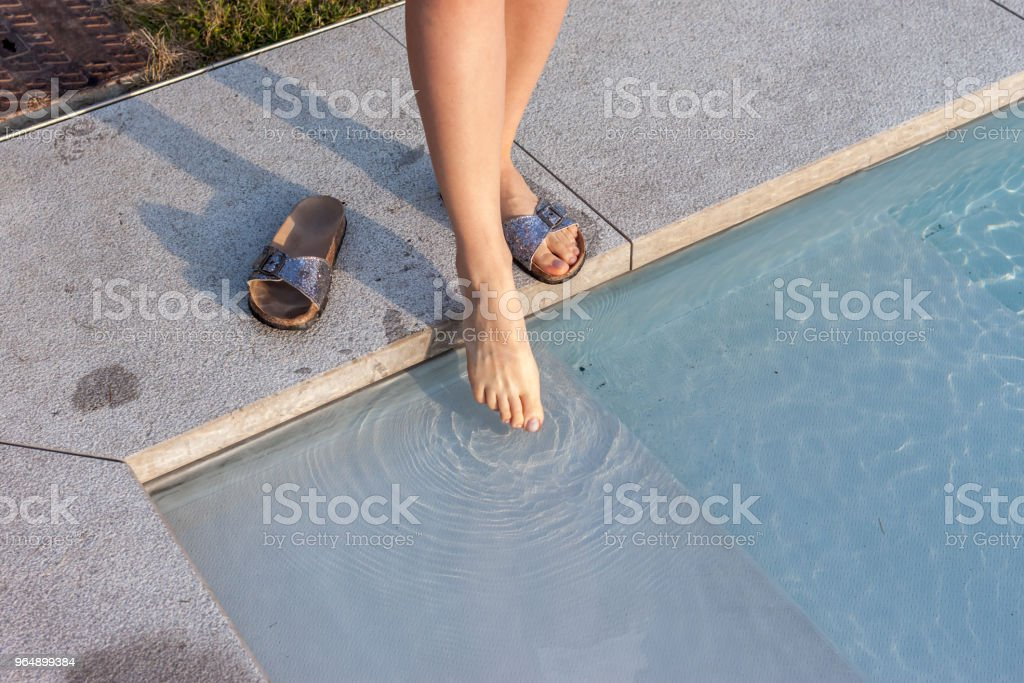 female leg touching water royalty-free stock photo