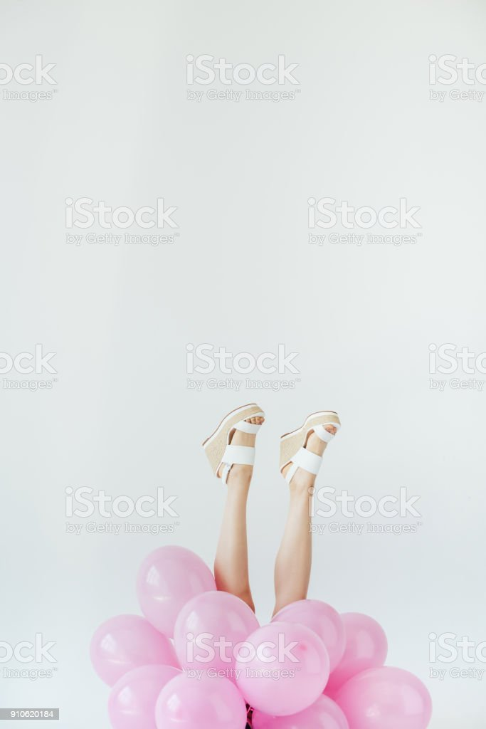 female legs and balloons stock photo