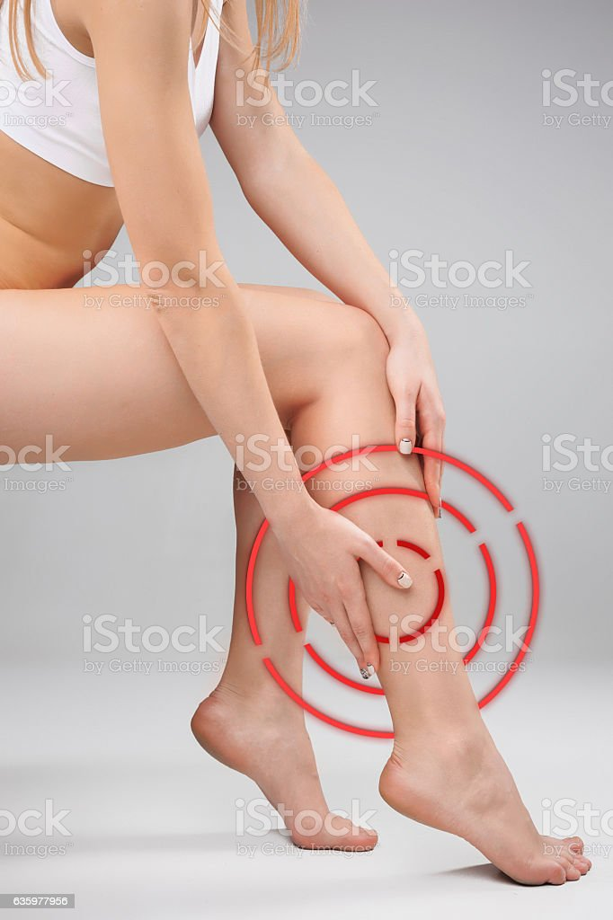 Female legs and hands, white background stock photo