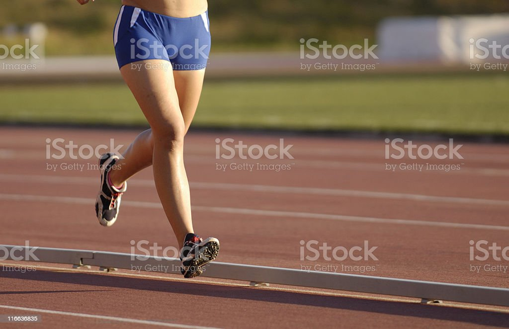 female legs at a morning race royalty-free stock photo