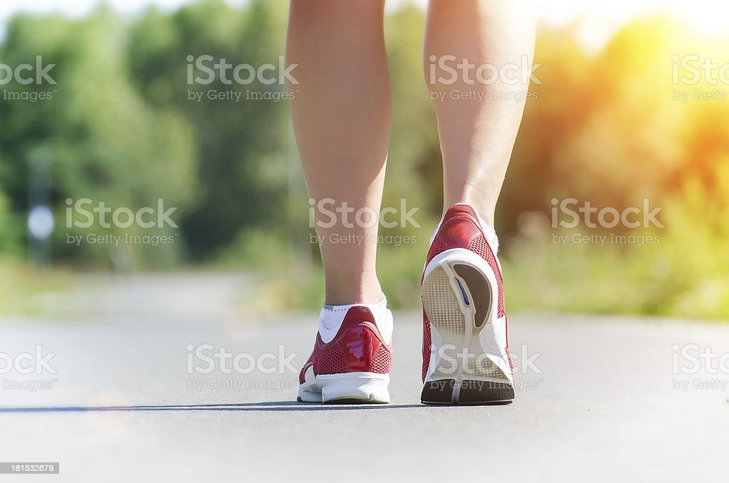 Female legs during outdoor workout at sunrise. Concept. royalty-free stock photo