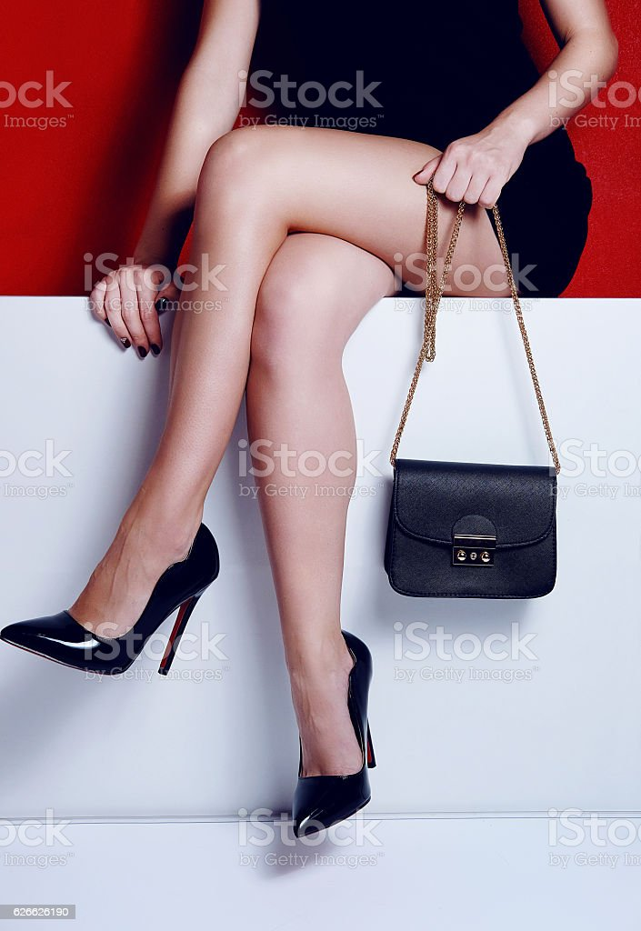 59f39770885 Female Legs In Black Dress With Bag High Heels Shoes Stock Photo ...