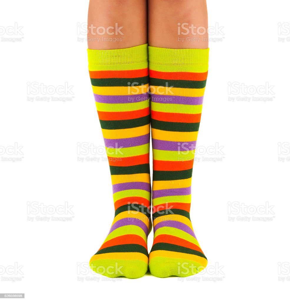 female legs in colorful striped socks stock photo