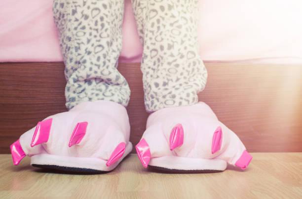 Female legs in cute pink monster foot slippers picture id927641170?b=1&k=6&m=927641170&s=612x612&w=0&h=guvvjsuran6id5xgon8utlxtqfip0 mhqz9vu4wd3dw=