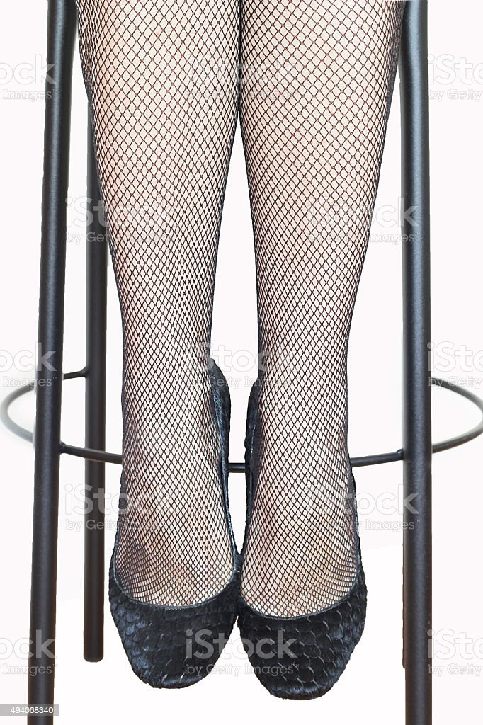 f5ffef3b8 Female legs in fishnet stockings isolated on a white background - Stock  image .