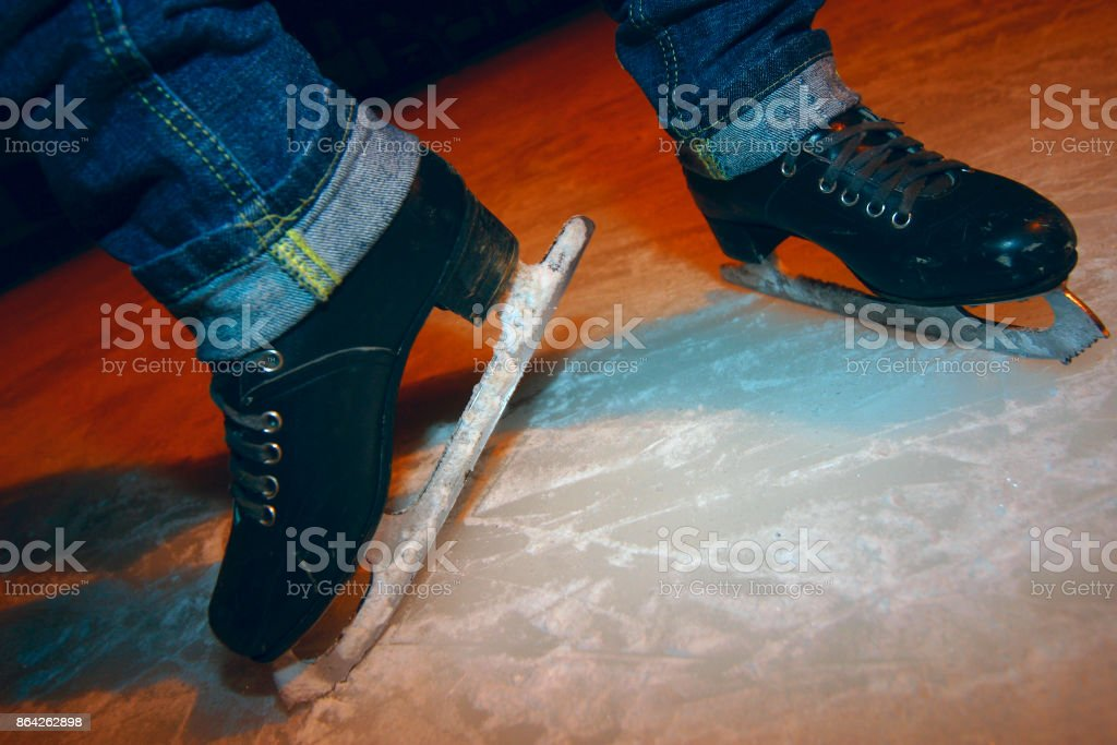 Female legs in jeans and skates stock photo