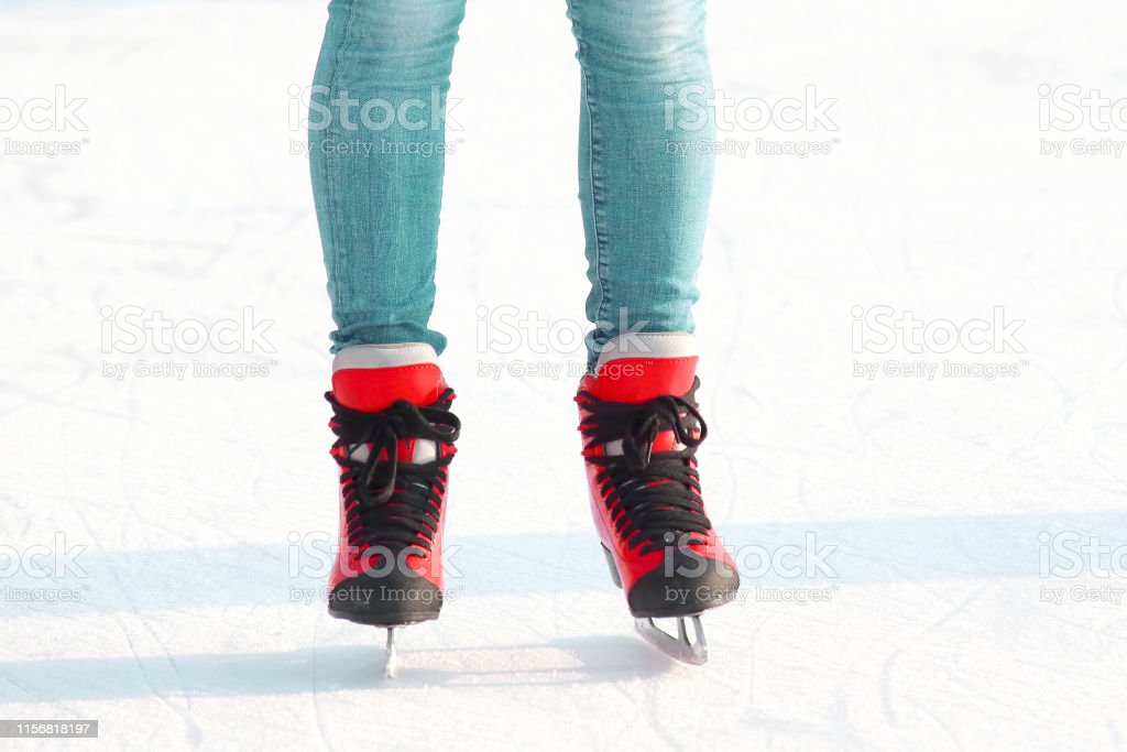 Female legs in skates on an ice rink. sports, Hobbies and recreation...