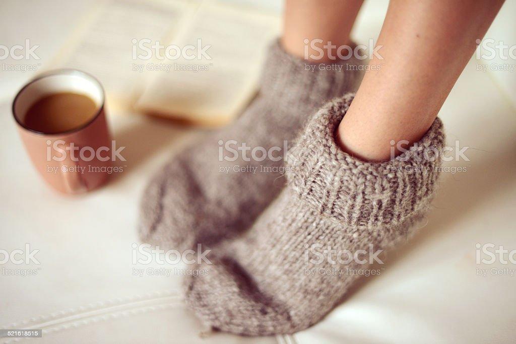 female legs in woolen socks close up stock photo