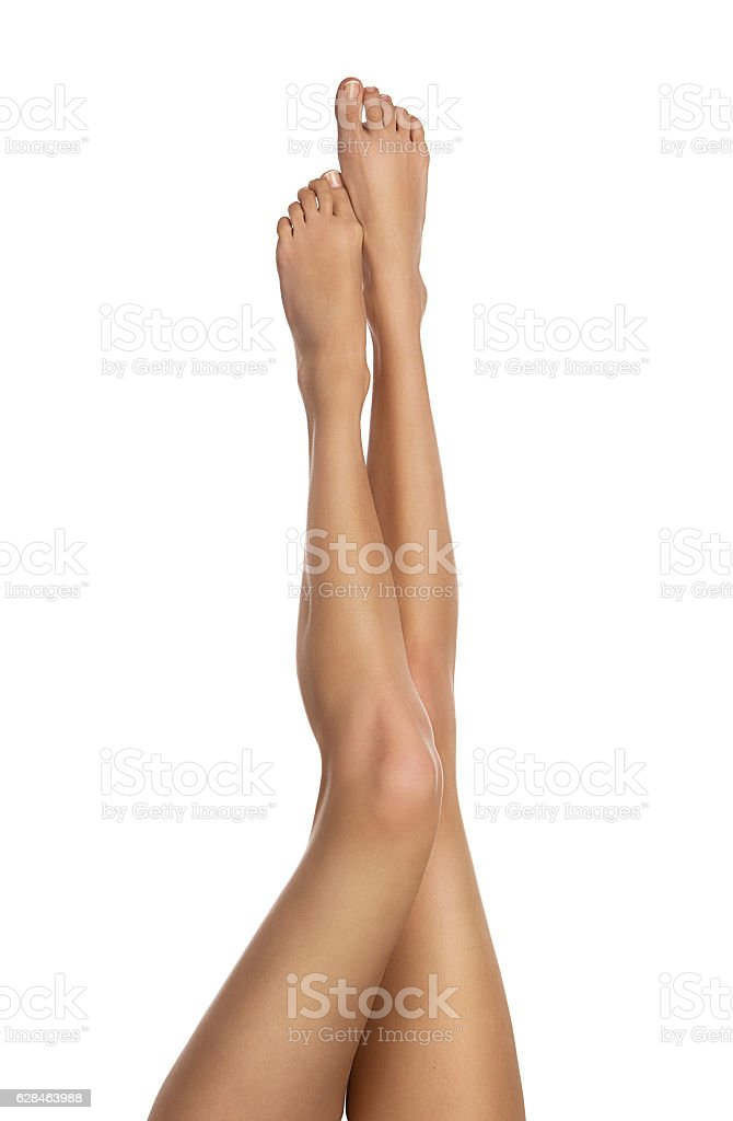 Female legs isolated on white stock photo