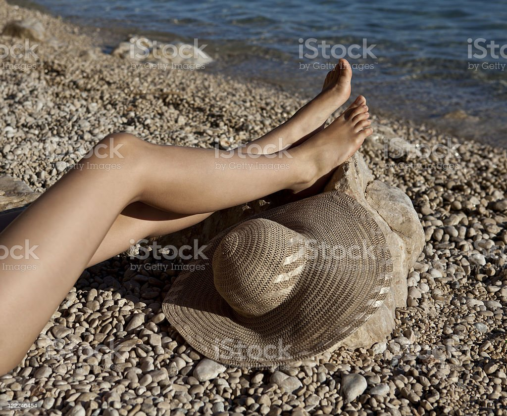 Female legs on the beach royalty-free stock photo