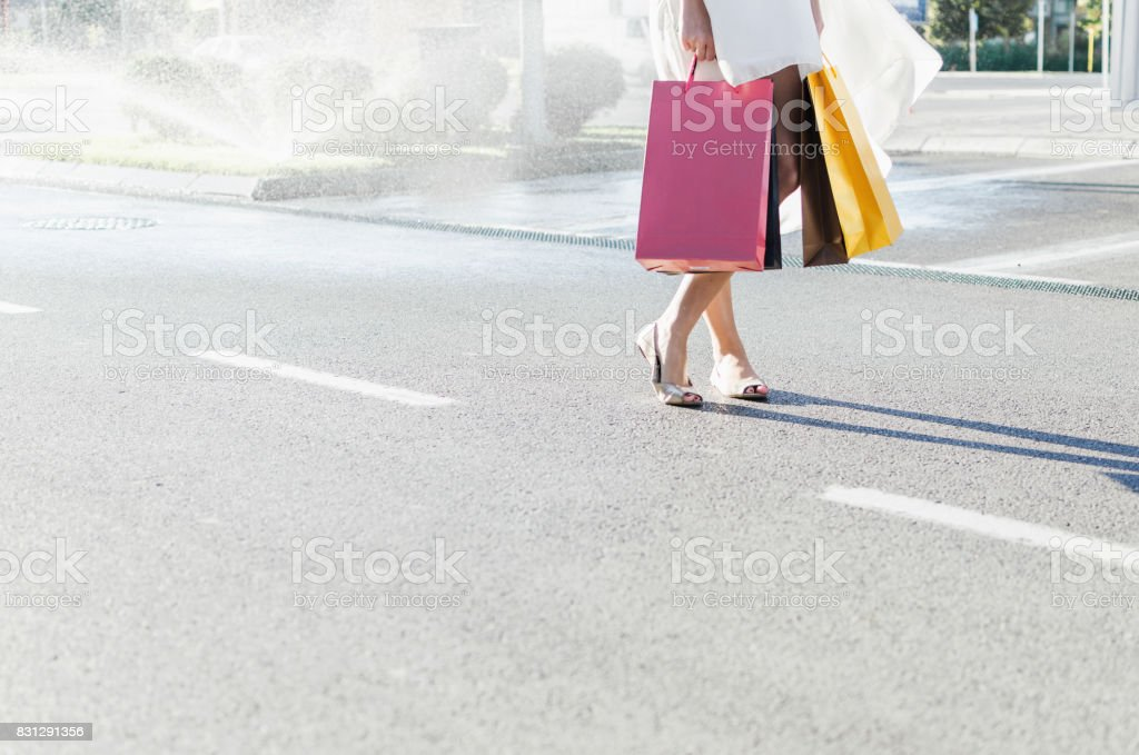 Female legs on the road trip stock photo