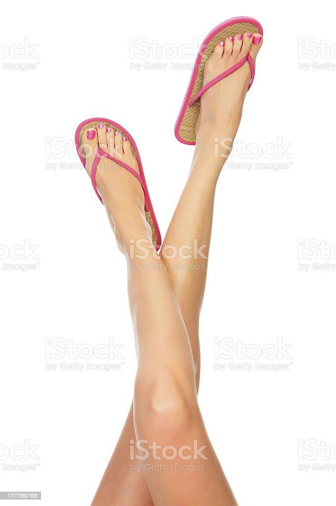 Female legs with flip-flops stock photo