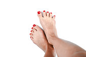 women feet after pedicure with red nails