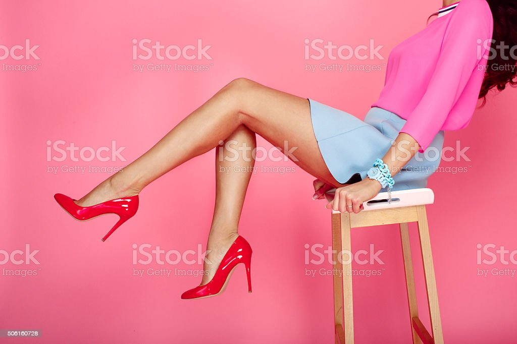 Female legs with red heels stock photo