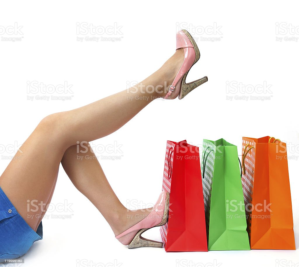 female legs with shopping bags stock photo