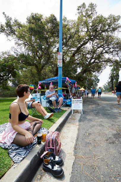 female LGBT supporter awaits the beginning of Pride Parade through Balboa Park to watch the Pride Parade stock photo