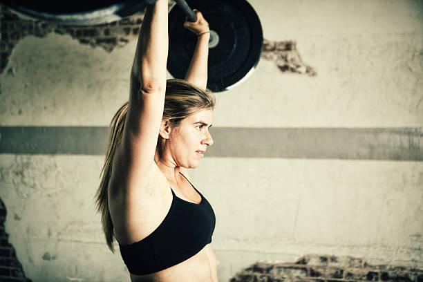 female lifting stock photo