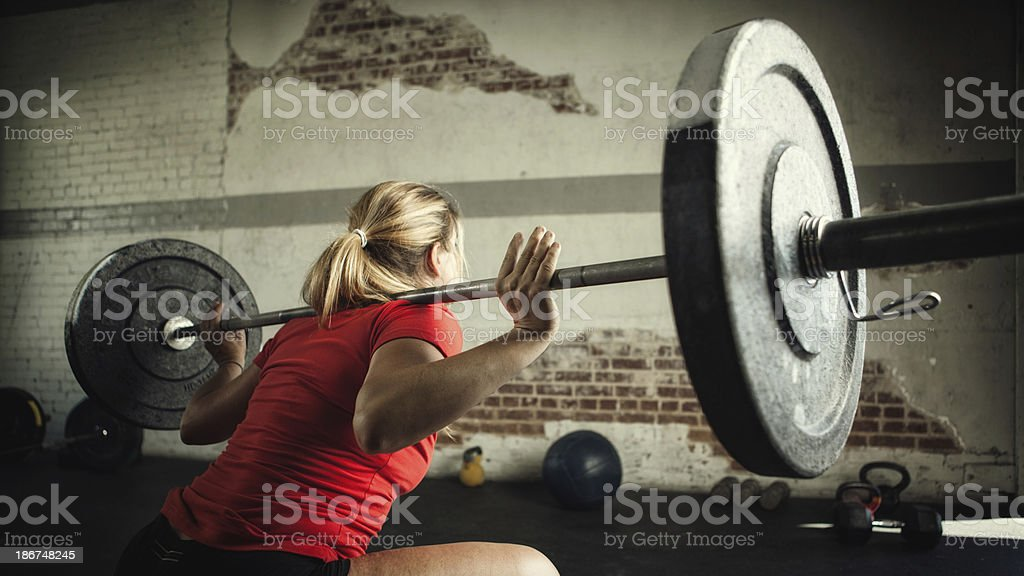female lifting weights stock photo