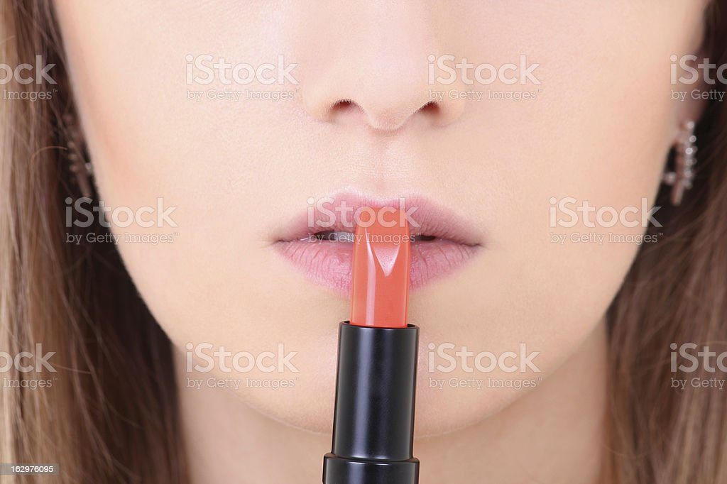 female lips with orange lipstick royalty-free stock photo