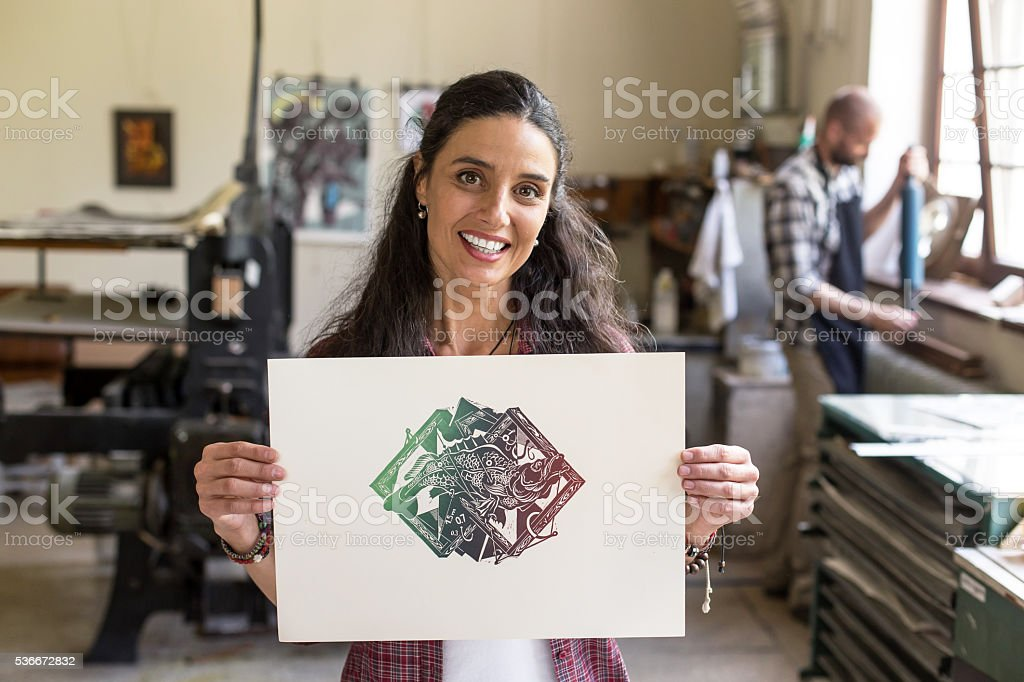 Female lithograph worker showing a new texture stock photo