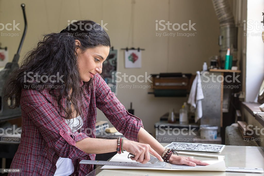 Female lithography worker at workshop stock photo