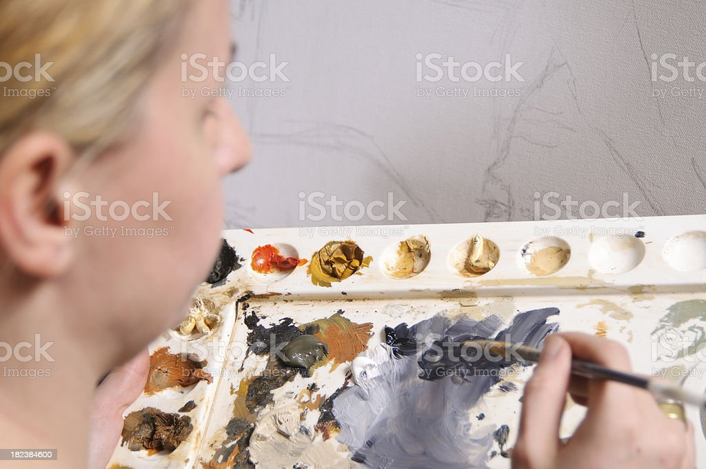 Female looking at own artwork royalty-free stock photo