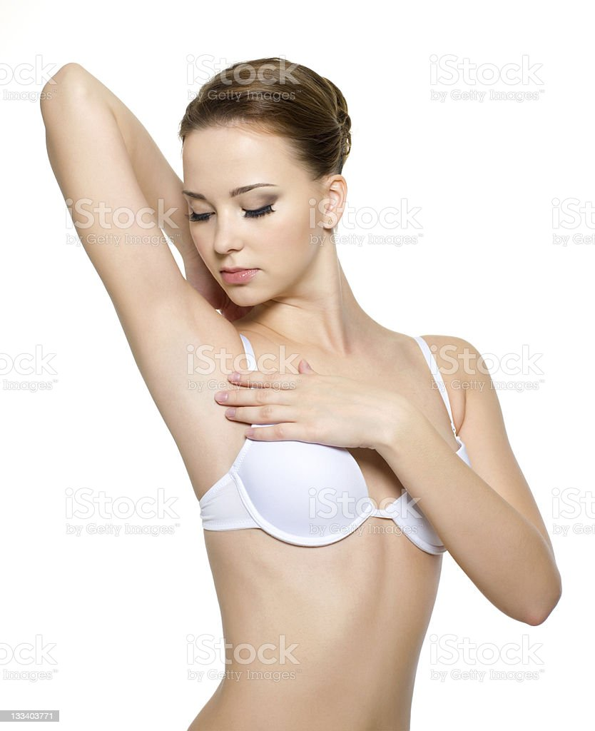 Female  looking on her clean armpit stock photo
