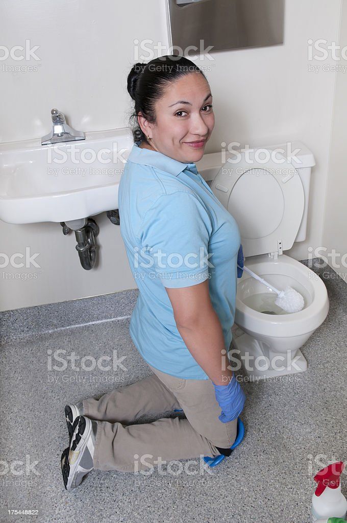 Female Maid Scrubbing The Bathroom Stock Photo More Pictures Of - Bathroom maid