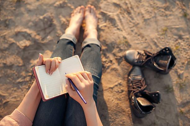 Female makes notes and sitting on the beach picture id590301724?b=1&k=6&m=590301724&s=612x612&w=0&h=piur1s2lg9rbplodzvnlym nvrfkybbytgmn n8ojdk=