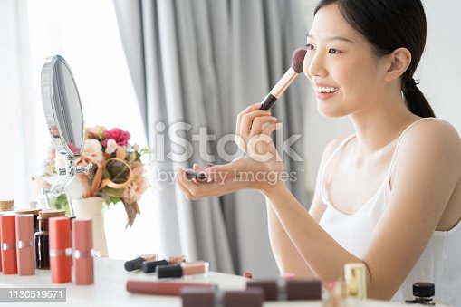 Young Asian female makeup beauty by Makeup Brush