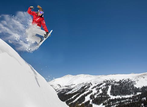 Female Making Extreme Snowboard Jump