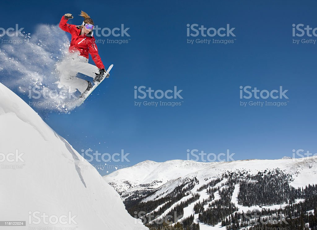 Female Making Extreme Snowboard Jump stock photo