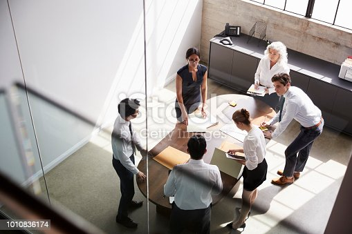 Female manager and business team in meeting, elevated view