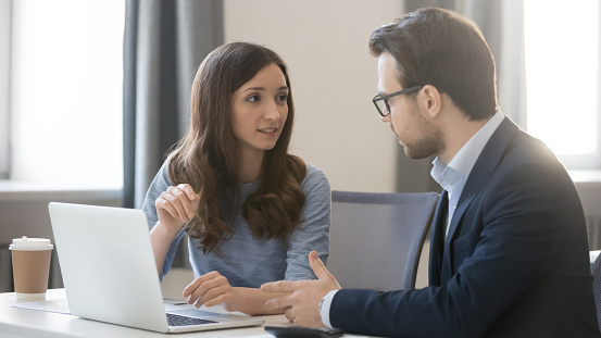 istock Female manager broker consulting client in corporate office with laptop 1135346229