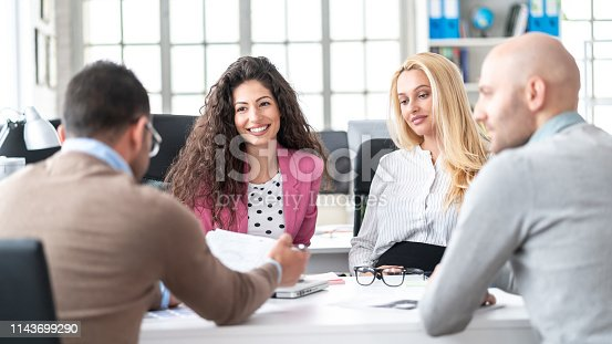 istock Female manager discussing business 1143699290