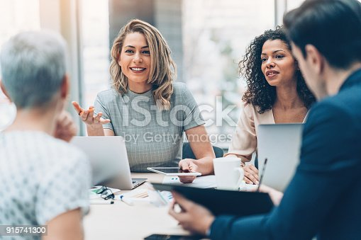 istock Female manager discussing business 915741300