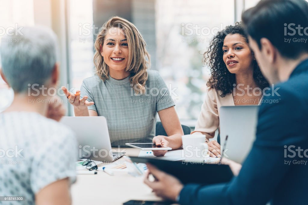 Female manager discussing business stock photo