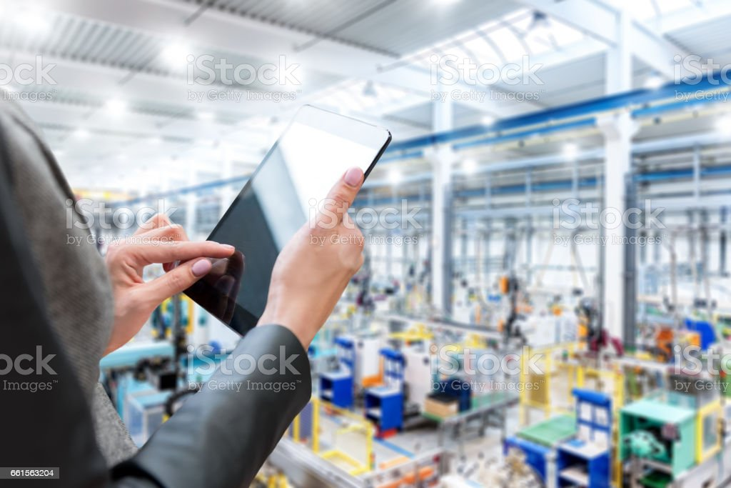 Female manager in factory & tablet stock photo