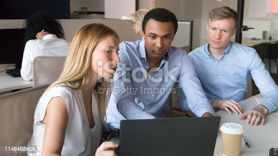 1031235468 istock photo Female manager mentor consulting diverse clients teaching interns with laptop 1146468405