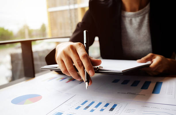 female manager putting his ideas and writing - market research stock photos and pictures