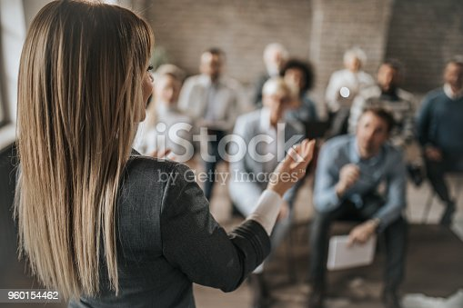 istock Female manager talking to large group of her colleagues on a business seminar. 960154462