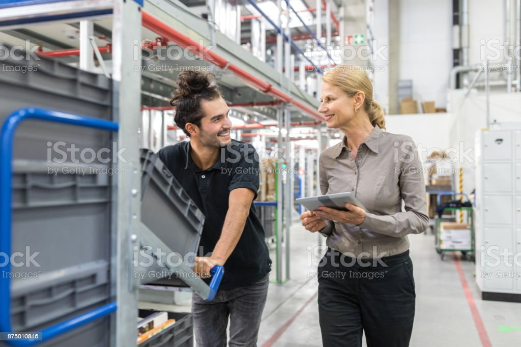 Female manager with worker in distribution warehouse stock photo