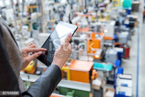istock Female manager working on tablet in factory 527045000