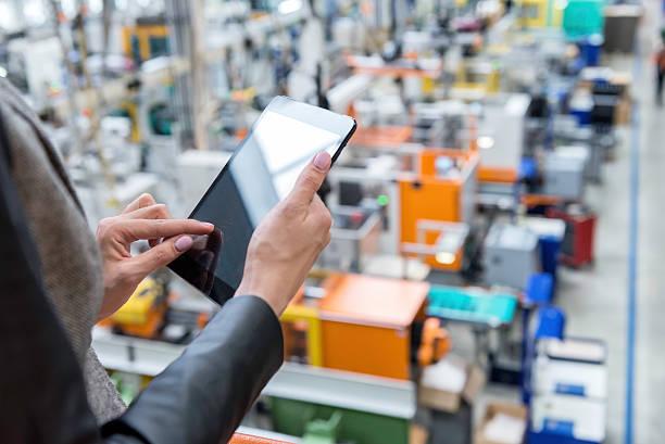 female manager working on tablet in factory - industrial connectivity bildbanksfoton och bilder