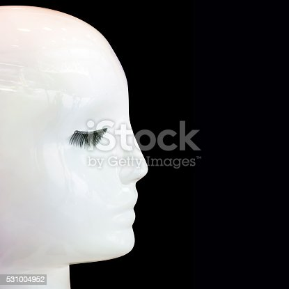 istock Female mannequin head-profile isolate on black background, copy space 531004952
