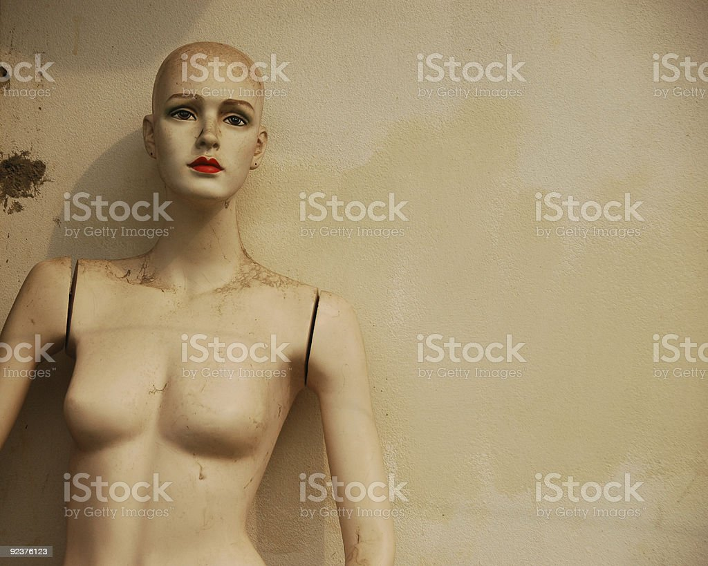 Female mannequin standing in front of the wall royalty-free stock photo