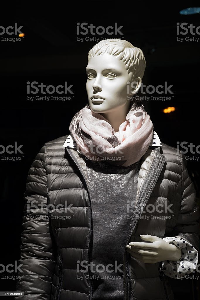 Female mannequin with anorak and scarf stock photo