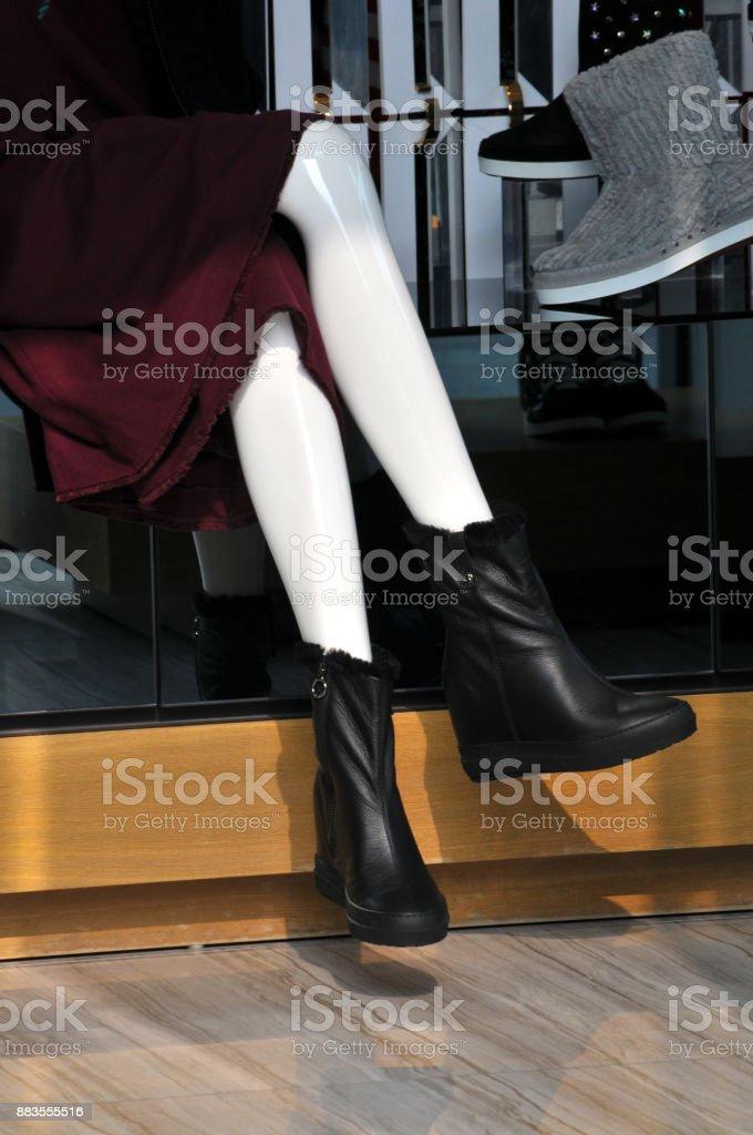 Female mannequins white legs in shopwindow stock photo