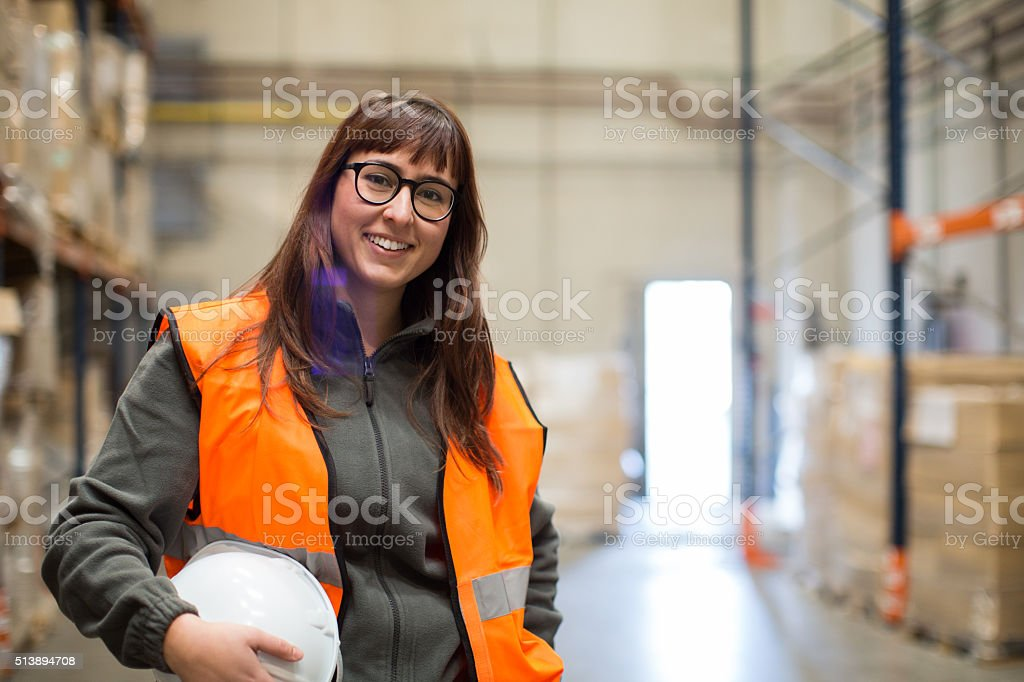 Female manual worker portrait smiling at camera. stock photo
